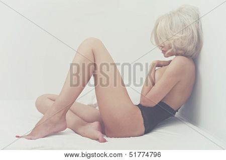 Fashion art portrait of young elegant woman in bed