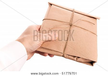 Male Hand Delivers Envelope Tied With A Rope Isolated On White Background