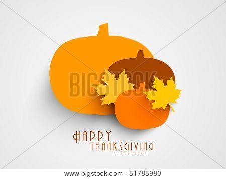Beautiful Happy Thanksgiving concept with pumpkin and maple leafs.