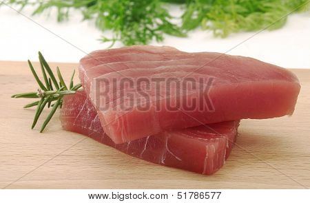 Tuna steaks and rosemary ingredient.
