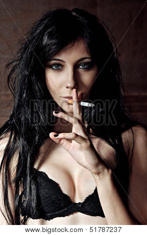 Pretty Young Girl Smoking Cigarette. Closeup