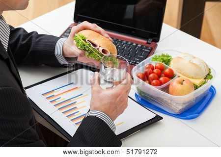 Manager Eating A Sandwich During Work