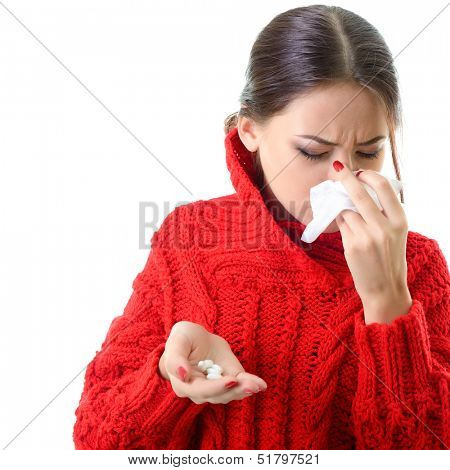 Young woman having flue taking pills, isolated on white