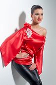 stock photo of tunic  - girl posing in red silk tunic and black leggings - JPG