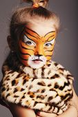 image of cute tiger  - little funny girl with tiger costume - JPG