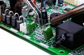 stock photo of circuits  - Electronic technician operates with circuit board - JPG
