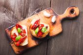 stock photo of antipasto  - Bruschetta with sun dried tomatoes basil leaves and garlic - JPG