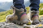 image of tramp  - two tramping boots before a mountain landscape - JPG