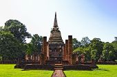 stock photo of vihara  - Buddhist stupa and the ruins of Vihara in Sukhothai province the first capital of Thailand - JPG
