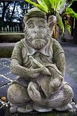 image of cheeky  - Cheeky monkey statue outside of the monkey forest in Bali