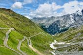stock photo of italian alps  - Winding serpentine moutain road in Italian Alps Stelvio pass - JPG