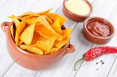 foto of table manners  - Tortilla chips with two different dips on a white table - JPG