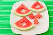 stock photo of watermelon slices  - Seedless watermelon slices cut with leaf shape cutter for kids fun meal - JPG