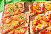 picture of flat-bread  - Baked flat bread with bell peppers and feta cheese and also with ham tomatoes and cheese - JPG