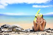 stock photo of sky diving  - Beach travel woman on Hawaii with sea sea turtle - JPG