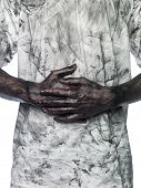 stock photo of doughy  - Dirty hands in front of a dirty shirt - JPG