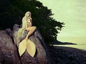 image of nymph  - Beautiful fashionable mermaid sitting on a rock by the sea - JPG