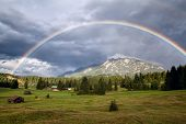 stock photo of bavaria  - colorful rainbow over Karwendel Alps and meadows Bavaria Germany - JPG