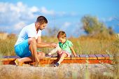 stock photo of bandage  - father bandaging injured leg of kid - JPG
