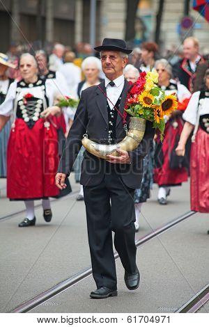 ZURICH - AUGUST 1: Swiss National Day parade on August 1, 2009 in Zurich, Switzerland. Representative of canton Zurich in a historical costume.