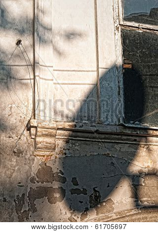 shadow of satellite antenna on the wall