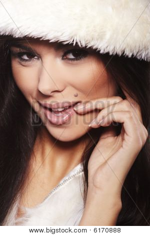 Teen Girl Wearing Fur Lined Coat Hood Against White Background.
