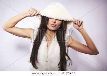 Teen Girl Wearing Fur Lined Coat Hood Against White Background.