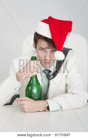 Young Man Celebrates Christmas At Office