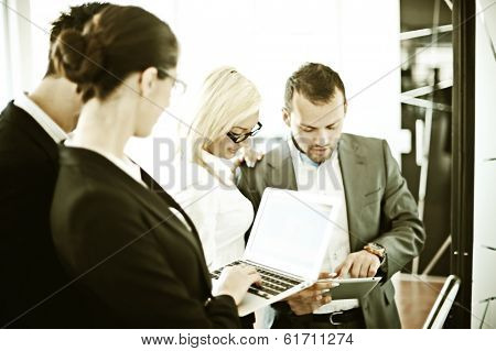 Business people working in office with instagram retro filtered effect