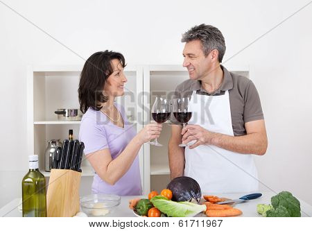 Senior Couple Cooking At Home