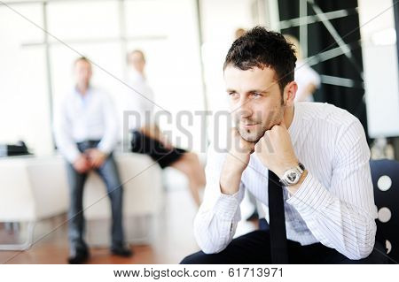 Business man having concerns about work