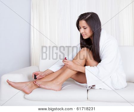 Woman Varnishing Her Toenails