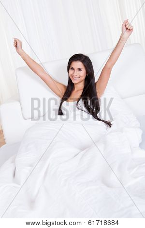 Refreshed Young Woman Rejoicing In Bed