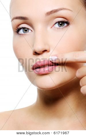 Beauty Female With Finger Near Her Lips