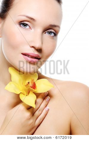 Beauty Female Face With A Yellow Flower