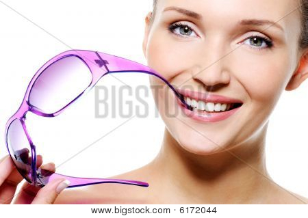Beautiful Smiling Woman With Fashion Violet Sunglasses