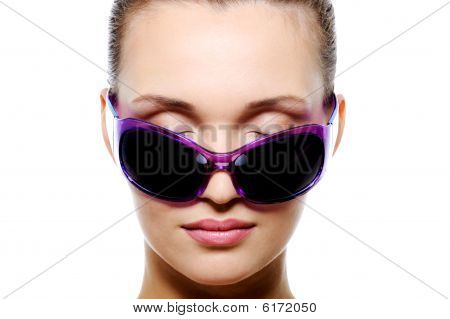 Front View Of Female Face In Dark Violet Sunglasses