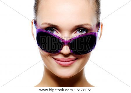 Smiling Woman Face In Dark Violet Sunglasses
