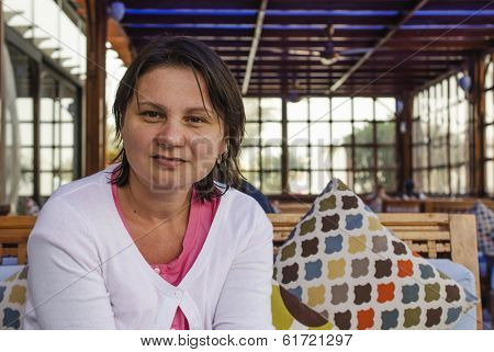 Adult woman sitting in kafe.Real people series.