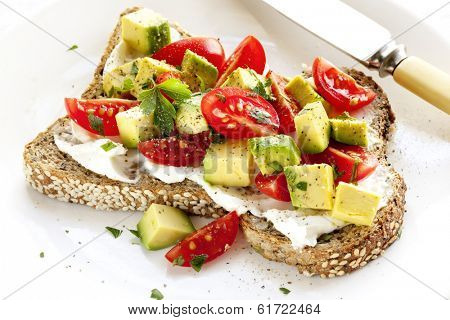 Toast with cream cheese, avocado and cherry tomatoes