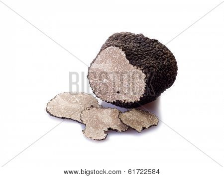 slice black truffle on white background