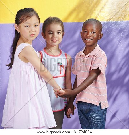 Interracial group of happy children in a kindergarten