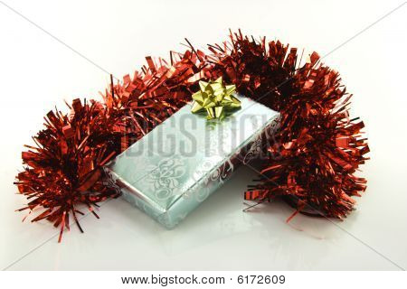 Silver Wrapped Gift With Tinsel