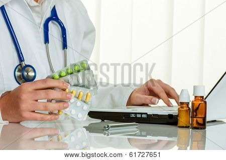 a doctor issues a prescription for medication. prescription tablets from the pharmacy.