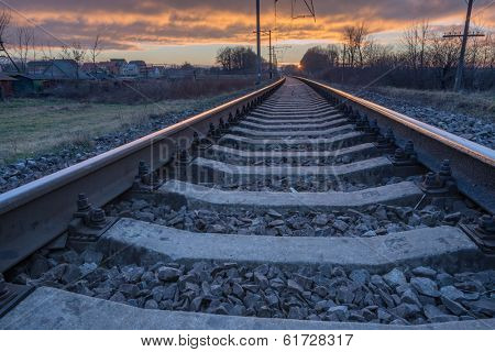 metal railway and orange sunset