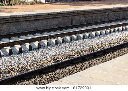 new railway tracks being laid beside an existing functioning railway track
