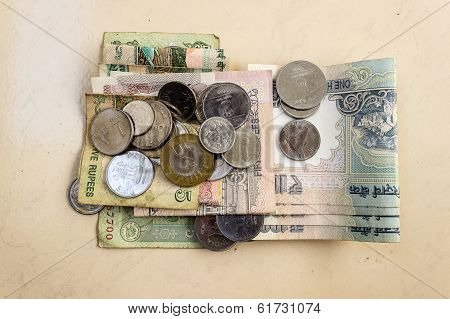 Indian currency notes and coins with various denomination