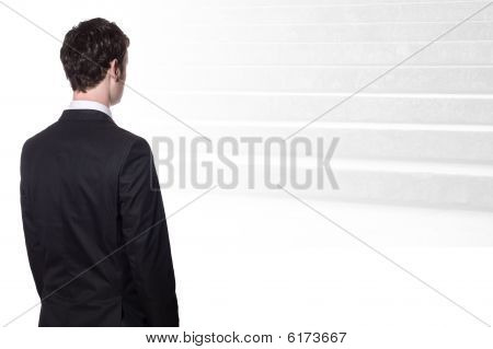 Businessman Looking At Stairs