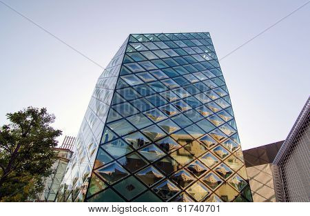 Tokyo - November 24: Rhomboid-grid Glass Building on Omotesando Street