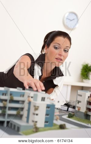 Young Female Architect With Architecural Model